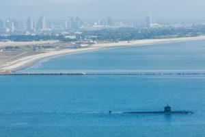American submarine leaving naval base in San Diego harbor, CA
