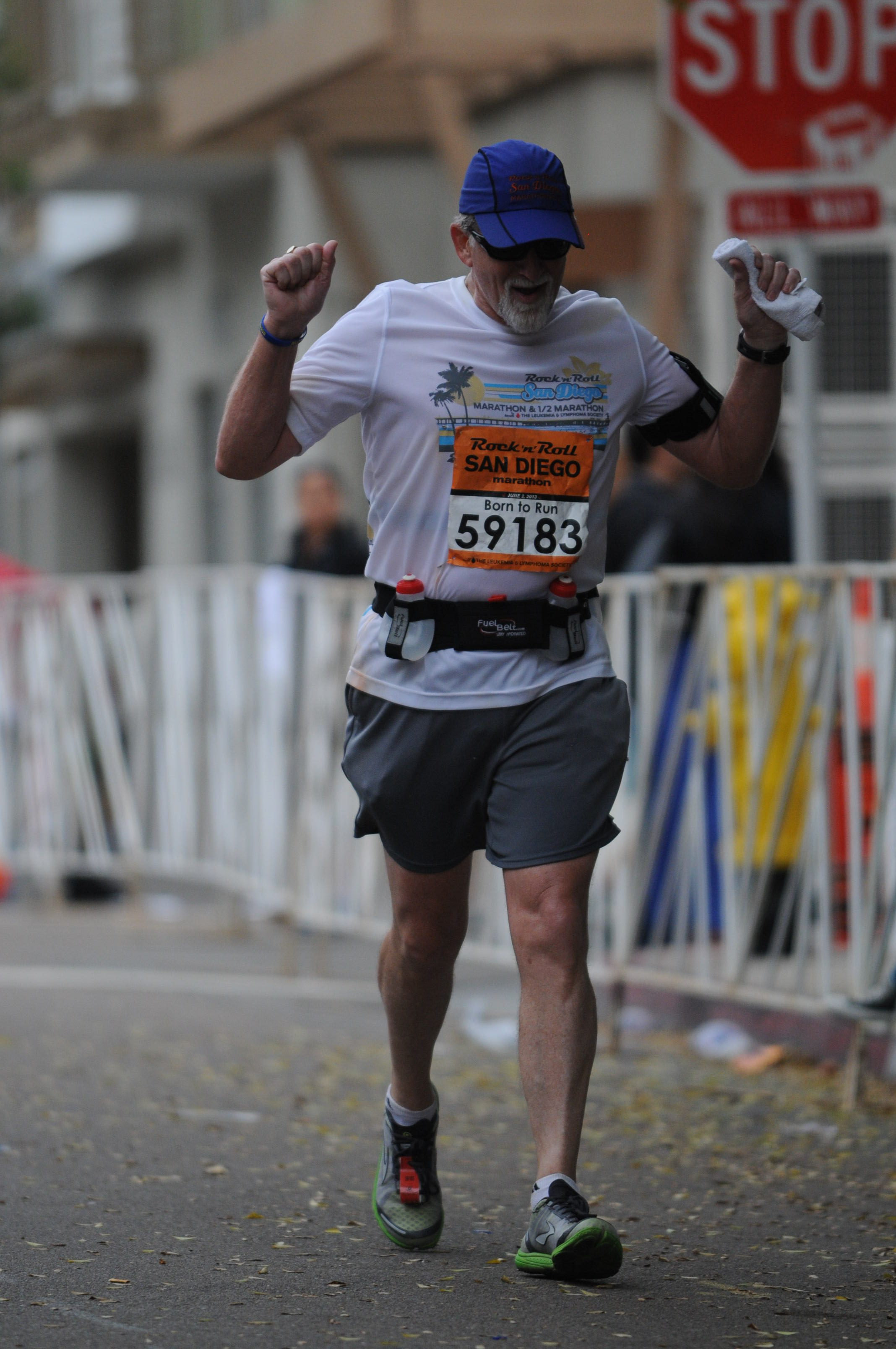 """Jogging"" across the finish line at 2013 San Diego Rock and Roll Marathon."