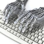 Robot works at keyboard.