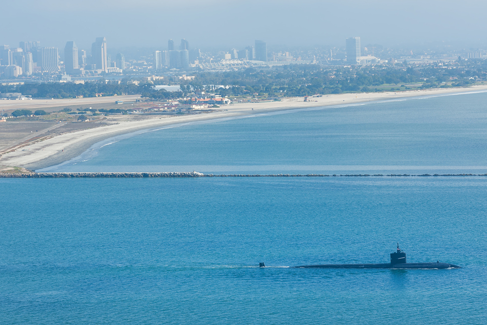 American submarine leaving naval base in San Diego harbor, CA